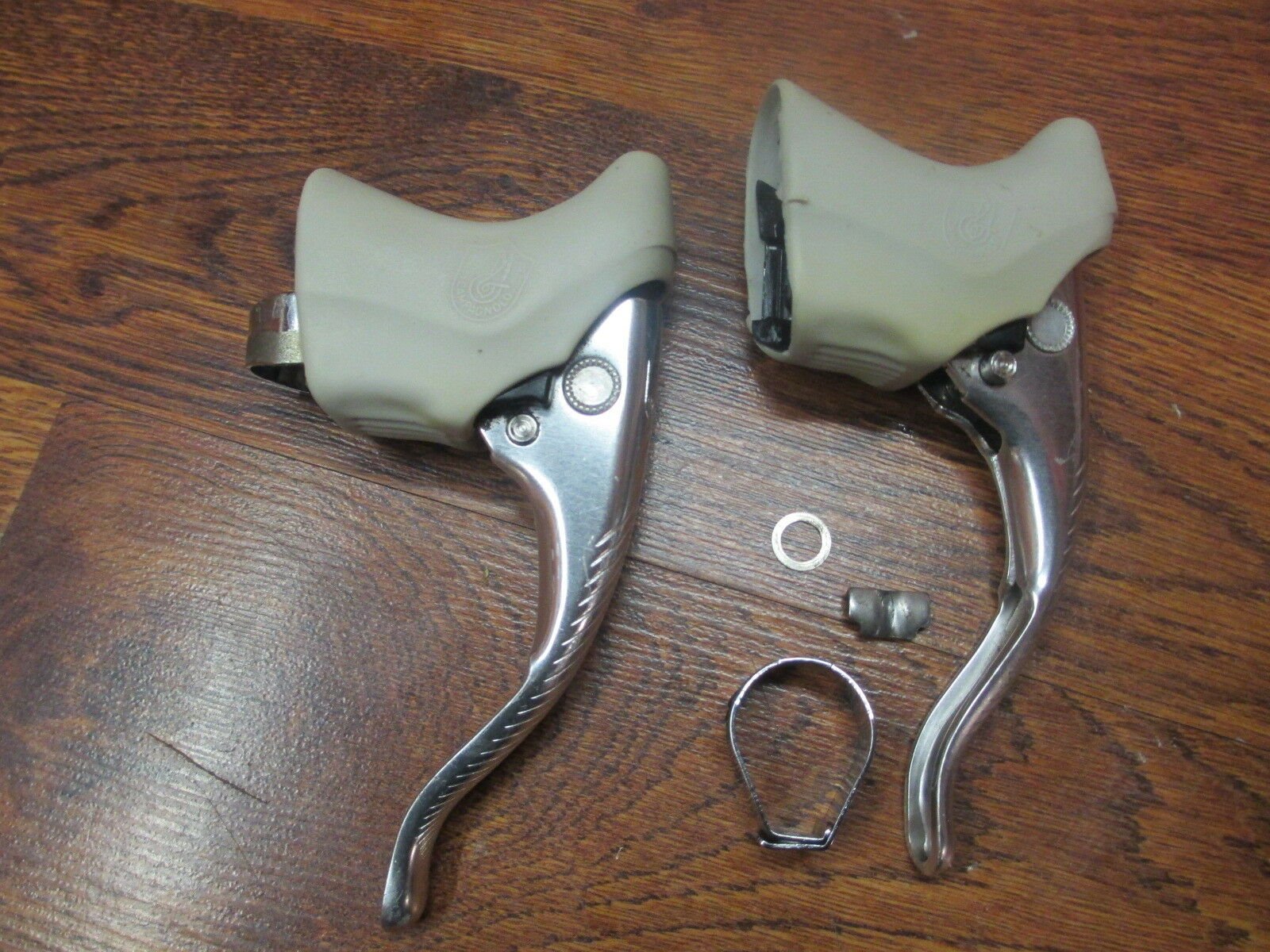 VINTAGE  CAMPAGNOLO RECORD BRAKE LEVERS WHITE HOODS - NOT COMPLETE  100% authentic