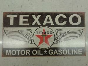 TEXACO MOTOR OIL AND GASOLINE METAL SIGN WEATHERED LOOKING 16 BY 10 INCHES