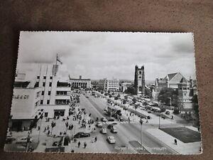 Real photographic Devon postcard - Royal parade street scene - Plymouth