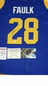 marshall-faulk-signed-jersey-JSA-certified-with-picture-of-marshall-signing-it