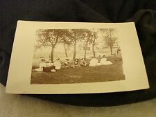 RPPC M.H. MOCKENHAUPT UN-POSTED LADIES SITTING WITH BABY & BUGGY ON IT'S SIDE EX