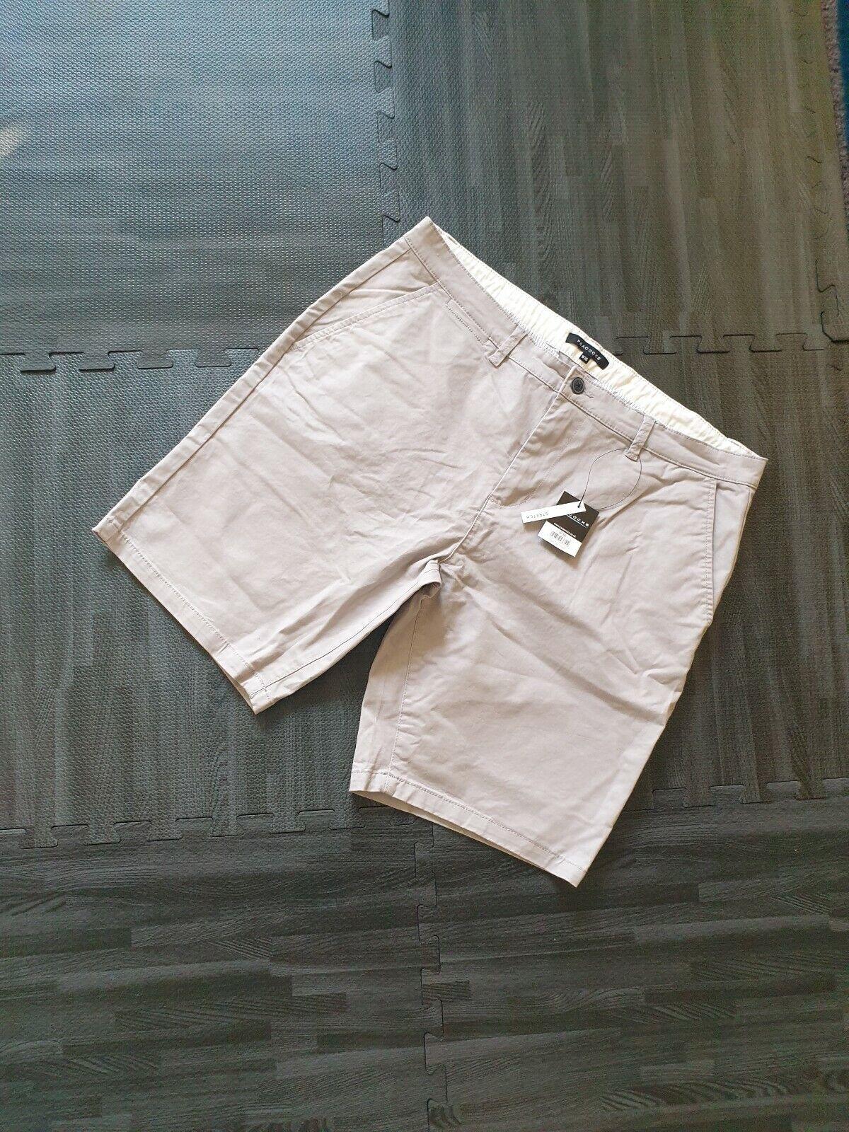 Pantalones cortos de hombre gris pavos reales 36W Nuevo con etiquetas