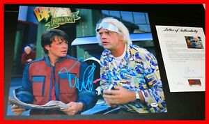 Michael-J-Fox-Christopher-Lloyd-Signed-Back-To-The-Future-2-16X20-Poster-PSA