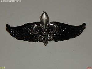46cc46c790f steampunk goth brooch badge pin wings fleur de lys French heraldry ...
