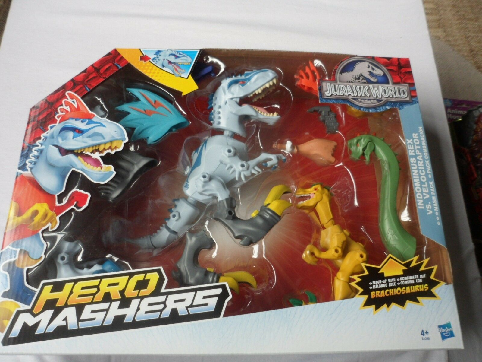 JURASSIC WORLD HERO MASHERS INDOMINUS REX VS. VELOCIRAPTOR