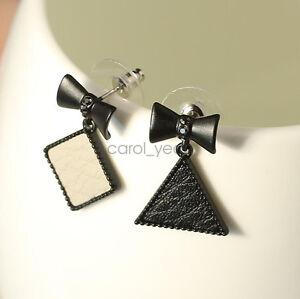 562451bab Black fashion simple solid bow leather wild ear stud asymmetric ...