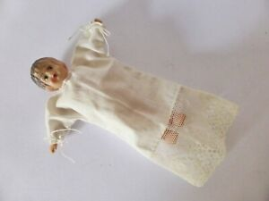 Vintage-Celluloid-Baby-Doll-in-Linen-Dress-1950s-Doll-Hand-Painted
