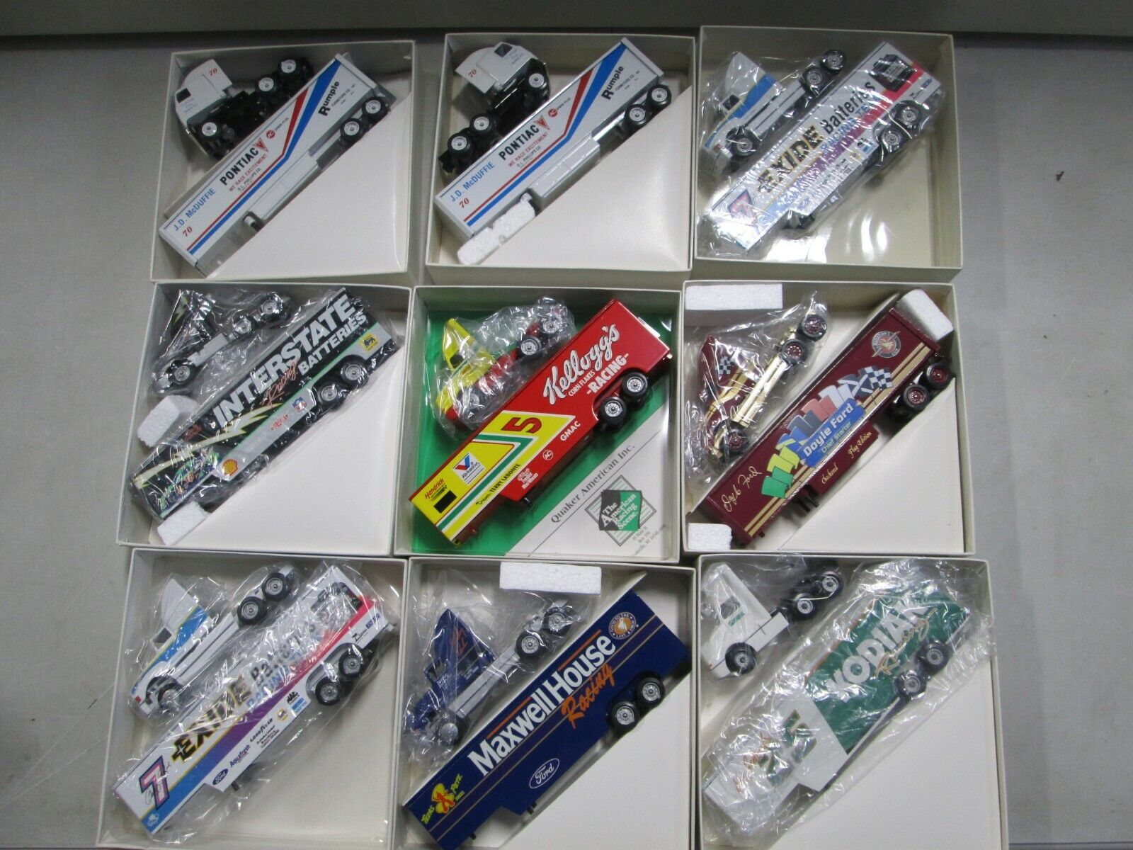 9 Assorted Winross Nascar Transporters (4)