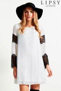 89fe4dfa534e Lipsy White   Black Chiffon Lace Sleeve Insert Swing Dress Size 10 ...