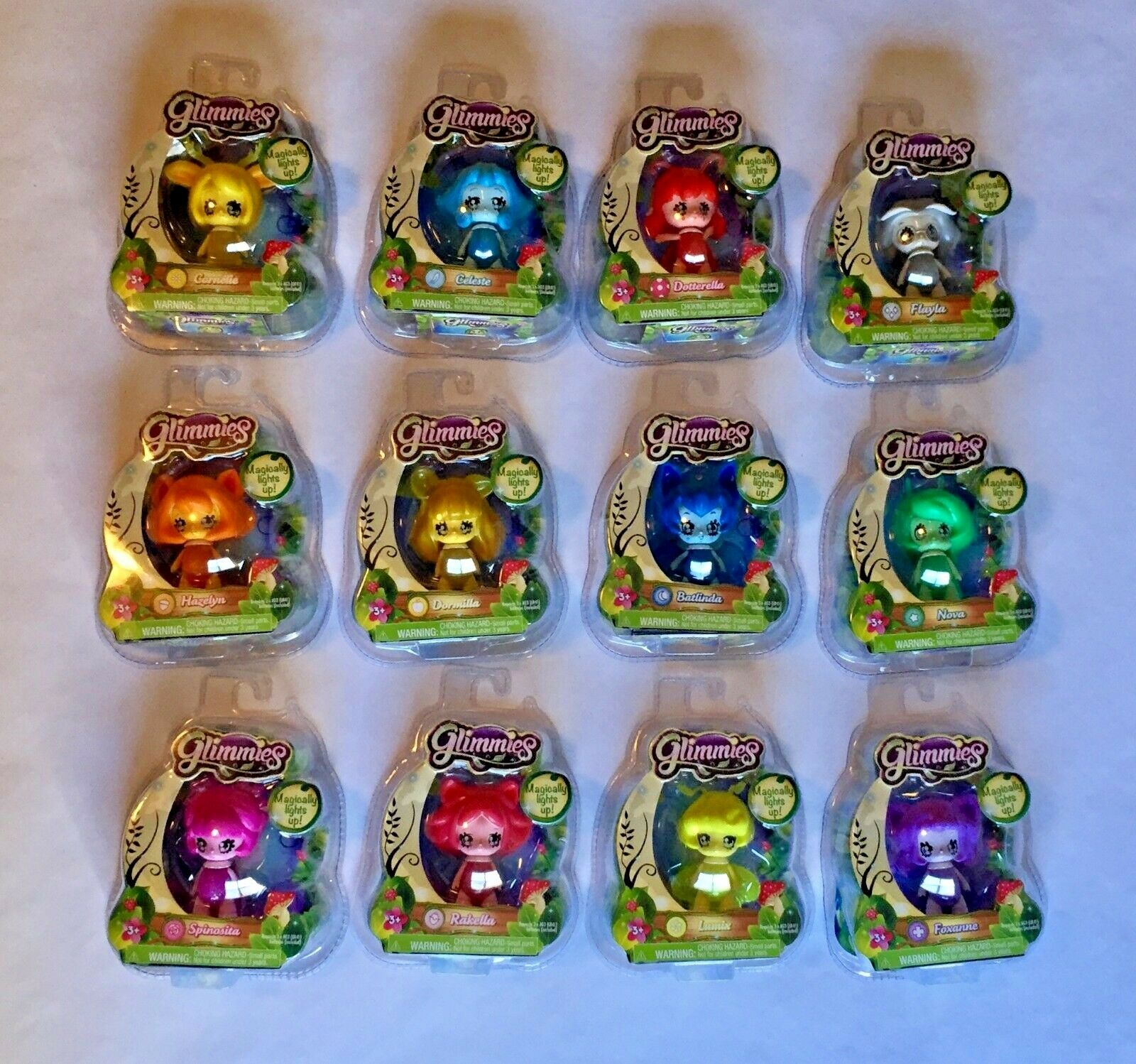 Spela bara Glimmies Set of 12 Figures 2.5 in Light Up Figures