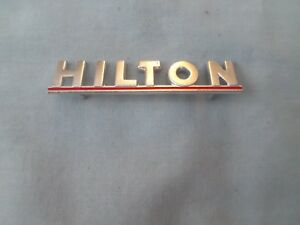 vintage metal sewing machine badge tag plaque hilton red
