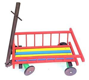 La traction en bois le long du chariot avec les roues et la poignée pour le stockage de jouet, planteur de fleur