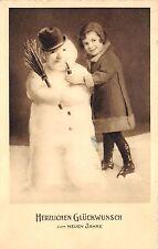 BG20673 child with snowman smoking new year neujahr   germany