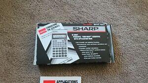 Sharp EL-506P Scientific Calculator user manual and  book. needs batteries