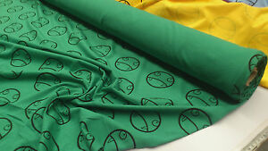 FUNNY-FANG-FACE-PRINT-GREEN-COTTON-JERSEY-148CM-WIDE-BY-THE-1-2-METRE