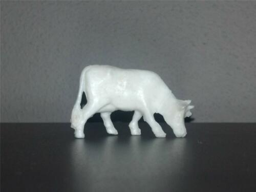White Plastic 40mm scale Miniature Tim-Mee Cow eating grass