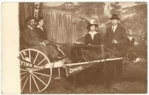 Men-amp-Women-with-Buick-Banner-Donkey-Cart-1910s-Studio-Real-Photo-Postcard