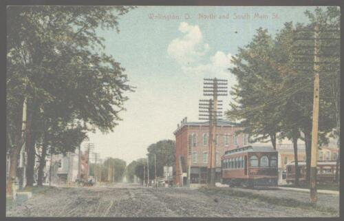 Postcard WELLINGTON OhioOH Main Street Business Storefronts with Trolley 1907?