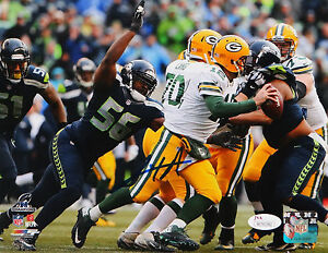 Cliff-Avril-Autographed-8x10-Seattle-Seahawks-Against-Packers-Photo-JSA-W-Auth