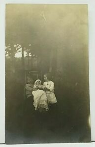 RPPC-Children-Holding-Crying-Baby-Real-Photo-Postcard-I9