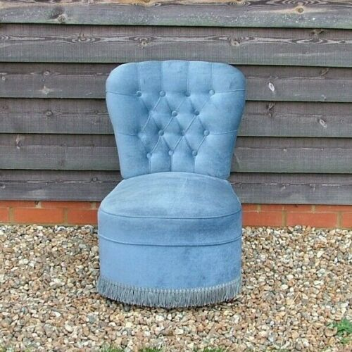Upholstered Blue Bedroom Chair With Button Detail On Back