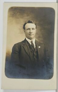 RPPC-Gentlemen-with-Unique-Lapel-Pin-c1907-Real-Photo-Postcard-K14