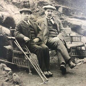 VTG-RPPC-Postcard-C-1900-1915-Men-w-Crutches-on-Wrought-Iron-Bench-Cliff-Side