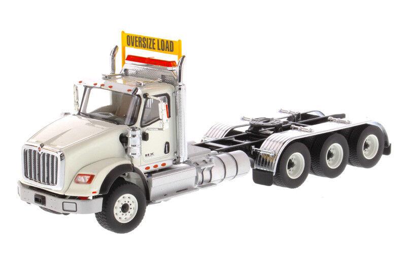 INTERNATIONAL HX620 DAY CAB TRIDEM TRACTOR WHITE 1 50 DIECAST MASTERS 71007