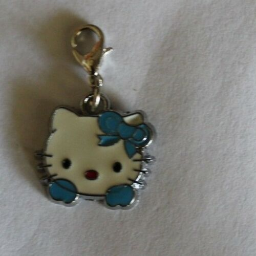 1 X  HEAD STYLE HELLO KITTY CLIP-ON-CHARMS,FOR BAGS//KEYRINGS,5 STYLES AVAILABLE.
