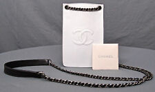Classic Auth CHANEL small smartphone crossbody case from 2014, lamb black sides