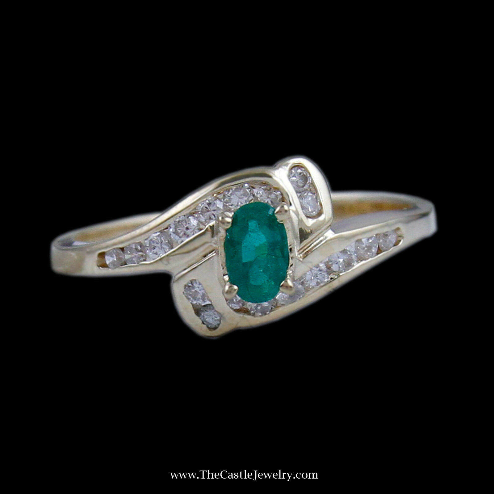 Beautiful Oval Emerald Ring in Bypass Diamond Mounting in Yellow gold