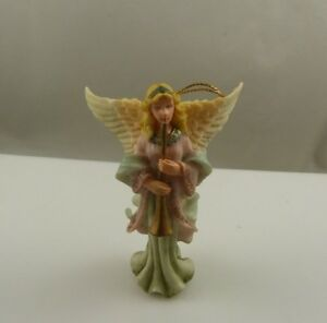 Christmas-ornament-Angel-holding-a-trumpet-plastic-or-resin-vintage-xmas