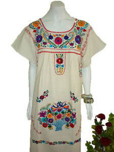 Vintage 1970s turquoise mexican cotton embroidered dress with scoop neck,  short sleeves, slits on
