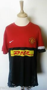 buy online a19e7 eeeb2 Details about Manchester United DHL Official Nike Football Training Shirt  (Youths 13-15 Years)