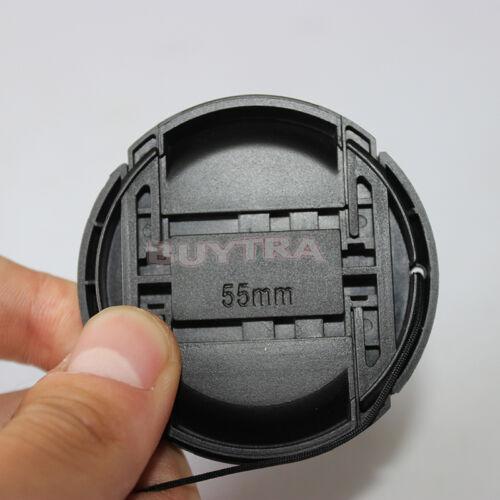 Centro pizca complemento en la tapa frontal para SLR cámara lente filtro de55mm