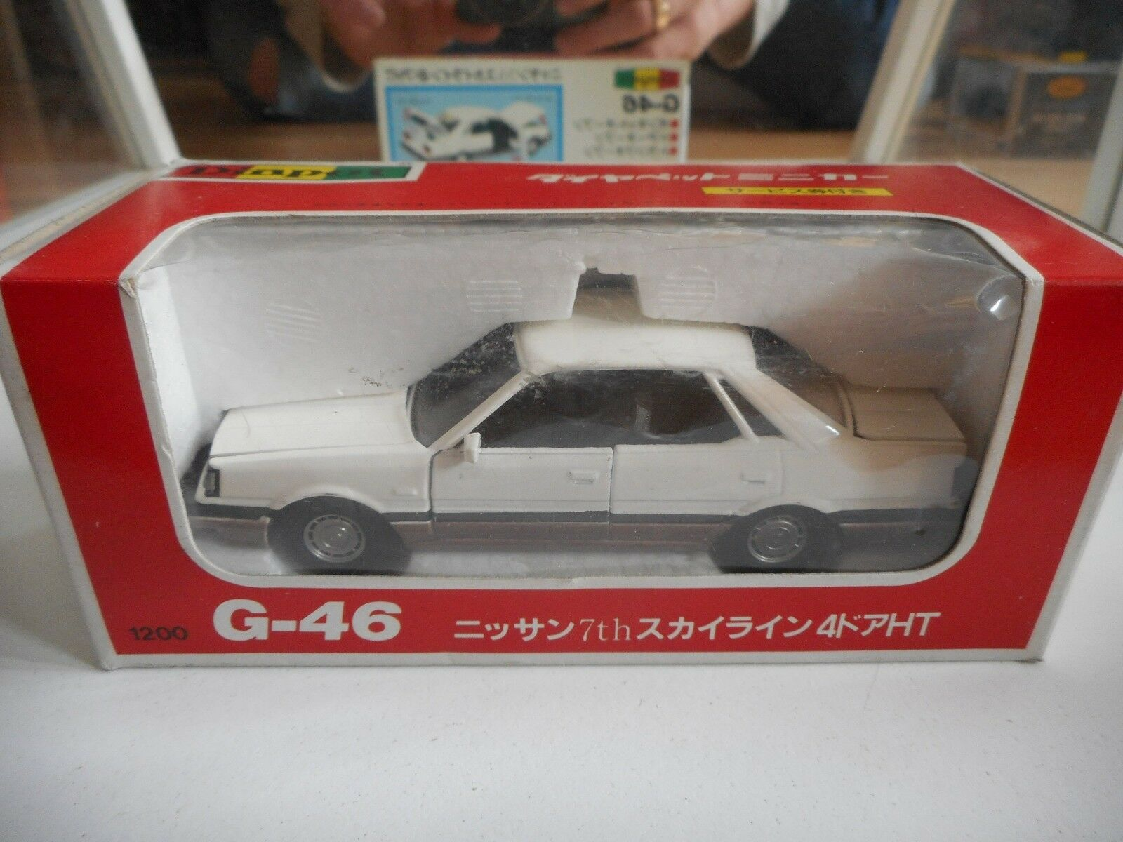 Yonezawa Diapet Nissan 7th Sky,ine 4-Door Hardtop in bianca on 1 40 in Box
