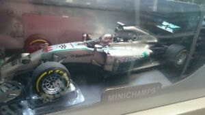 1-18-Minichamps-Mercedes-AMG-Petronas-Winner-Abu-Dhabi-2014-World-Champion-Hamil