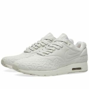 d21a96391073 NIKE WOMEN S AIR MAX 1 ULTRA PLUSH   LIGHT BONE GREY ATOMIC PINK ...