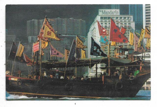 HONG KONG Chinese junk decorated for TIN HAU FESTIVAL sails past THE MANDARIN