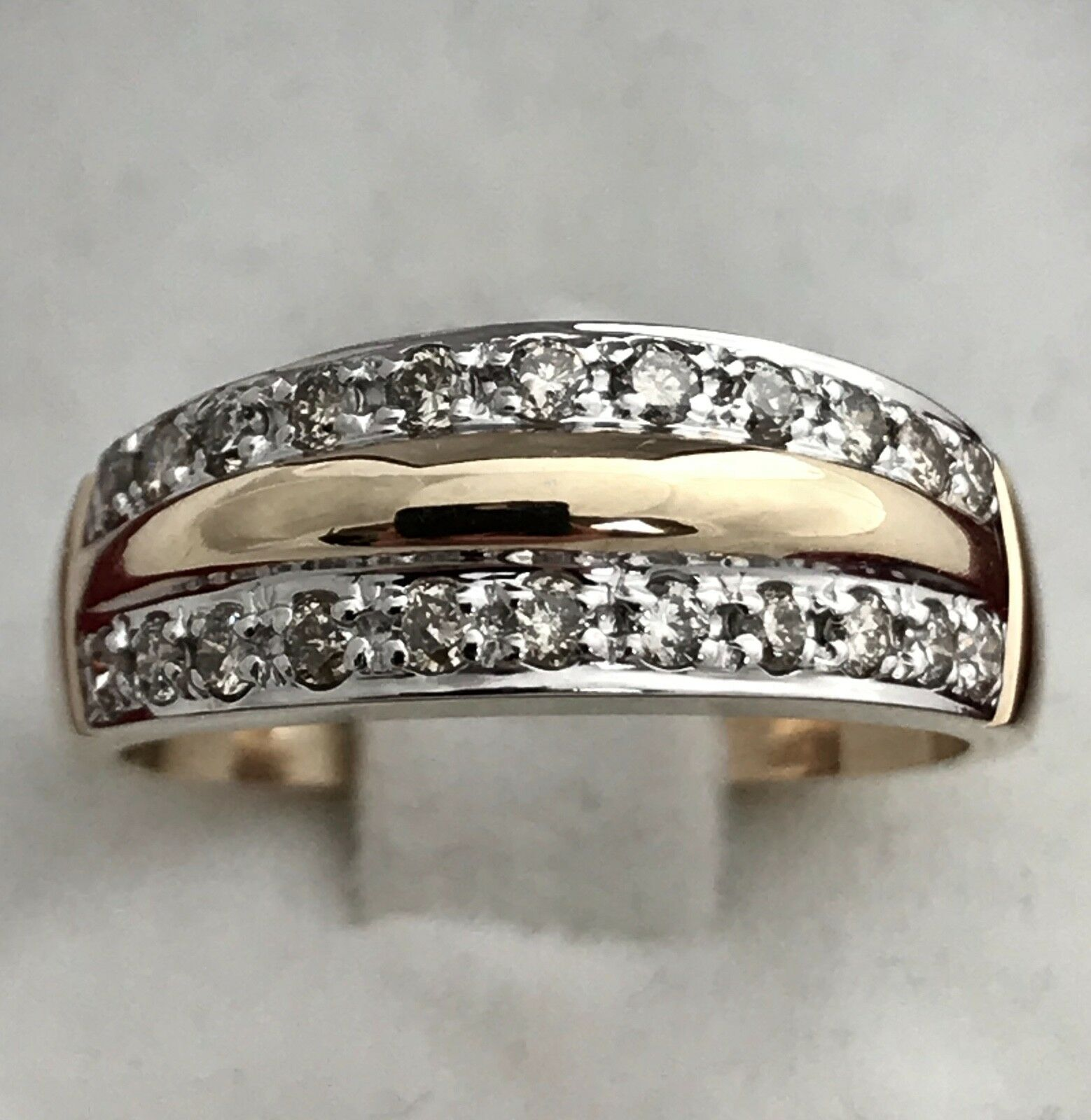 DIAMOND RING IN 14K YELLOW & WHITE gold SET WITH APPR. 0.40 CARAT OF DIAMONDS