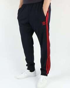 a6a7a60d Adidas Superstar штаны с манжетами трек в темно-синий и красный ...