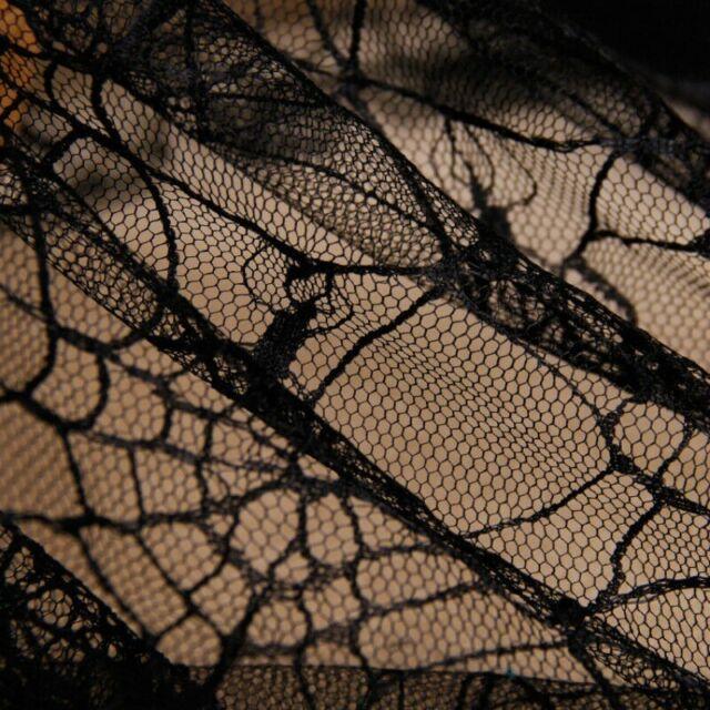 Henry Glass Fabric Metallic Fright Night Skeletons Black HALF METRE