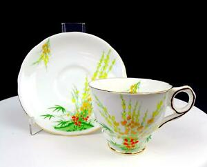 "ROYAL STAFFORD ENGLAND BROOM PATTERN YELLOW AND ORANGE FLOWER 3"" CUP & SAUCER"