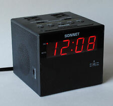 USB CHARGING STATION w/AM/FM ALARM CLOCK RADIO, 110V OUTPUT PLUGS, AND MORE.