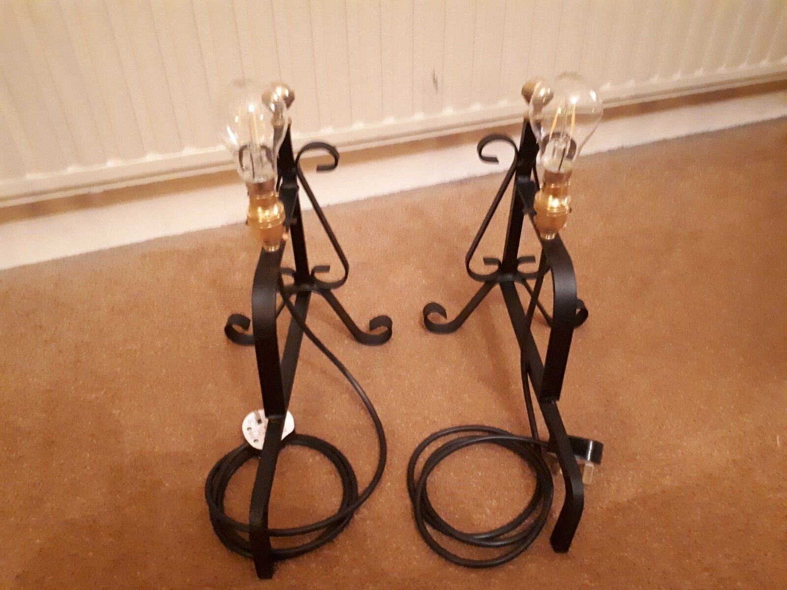 A PAIR OF VERY RARE UNIQUE ( ONE OFF ) WROUGHT IRON, FIRE DOG TABLE LAMPS.