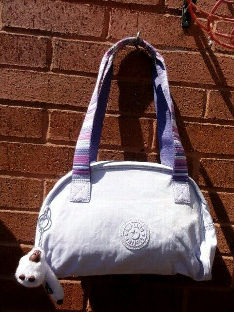 mauve and pink kipling bag