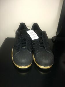 adidas superstar metallic gold black