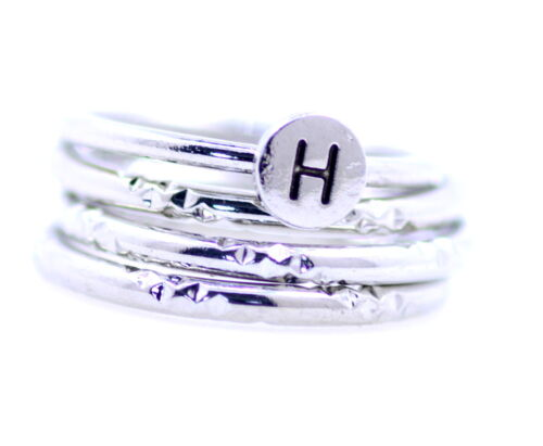 Silver tone set of 4 band ring with letter H UK Size N