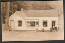 unmailed Kodak RPPC photo post card people standing in front of a building/shop