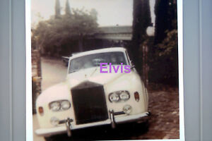 ELVIS-PRESLEY-IN-WHITE-ROLLS-ROYCE-CAR-COMING-OUT-FROM-BEL-AIR-HOME-PHOTO-CANDID